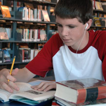 High School Boy Working in Library