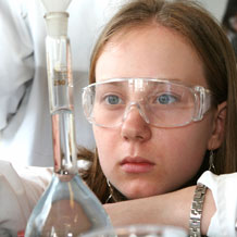 High School Girl Observing Beaker