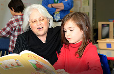 Dr. Bresell spends time reading with a young student