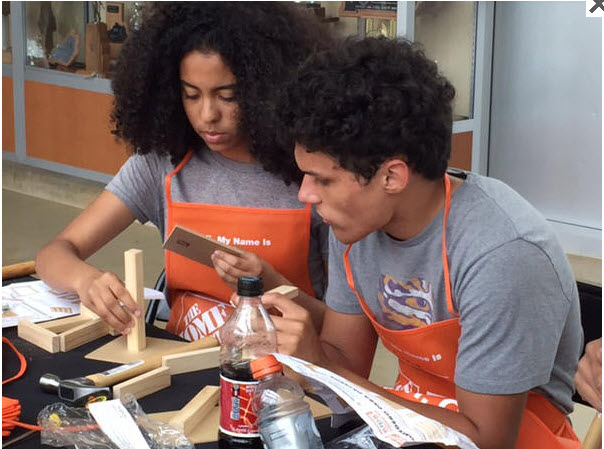 Students working with Home Depot project kits