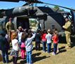 An 82nd Combat Aviation Brigade  helicopter lands at Gordon Elementary School.