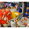 Two 2nd graders in Ms. Erny's class explain how they built and programmed their Lego ferris wheel and see-saw.