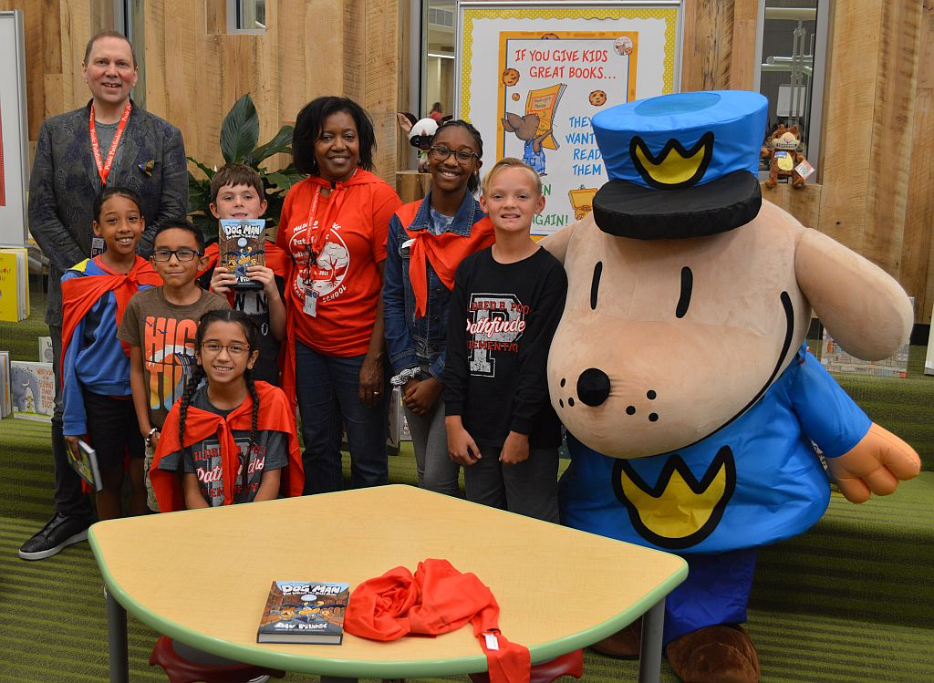 Students celebrate reading with author Dav Pilkey and Information Specialist Mrs. Salters.