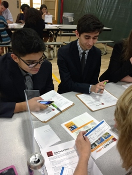 Students participate in a financial planning workshop.