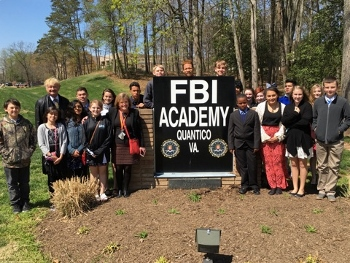 Students in the QMHS AVID middle and high school program embracing a rare, personal tour of The FBI Academy and grounds, located on the United States Marine Corps Base in Quantico, Virginia Middle. Students were escorted by a Special Agent who provided information and  many interesting facts about the Academy and FBI.