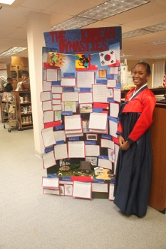 A student uses a visual display for her National History Day presentation.