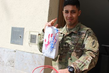 A single soldier happy to receive a bag at his dorm during the Single Soldier Project 2017.