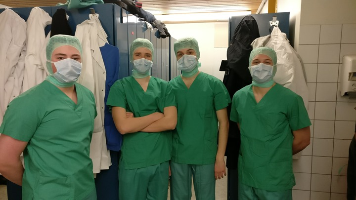 Tevis Amblad (SHS'18), AidAn DeHan (SHS'18), Ellis Ward (SHS'19), and Zac Semanski (SHS'17) ( Left to Right) dressed in hospital scrubs prepare to see over seven different surgeries throughout the day.