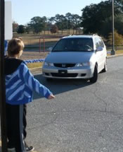 Safety Patrol directing car line