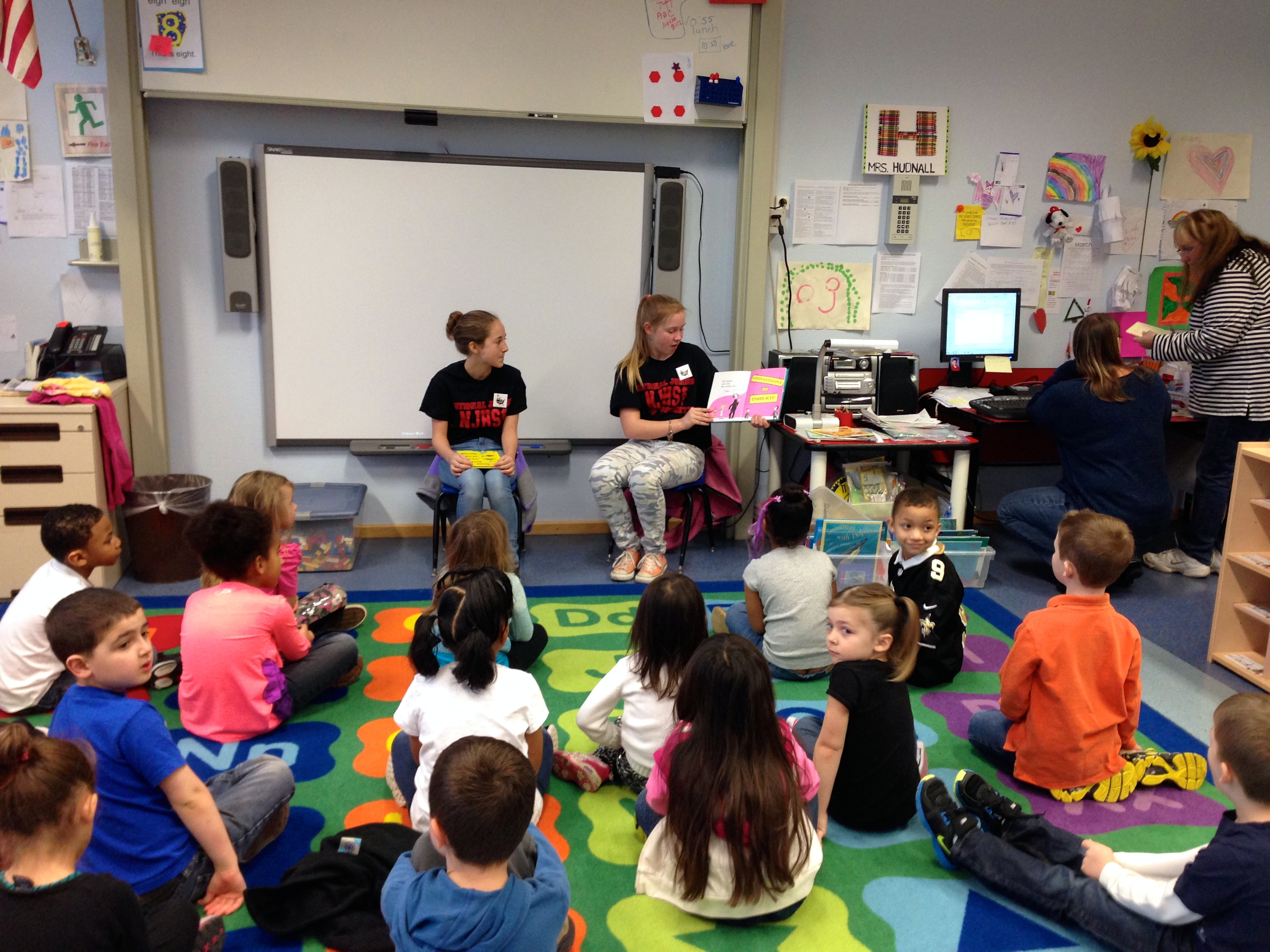 NJHS members read to a group of Kaiserslautern Elementary students.