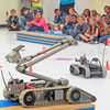 An Army robot operated by soldiers with Fort Stewart's 38th EOD climbs over an obstacle Thursday during Diamond Elementary School's Robot Fest.