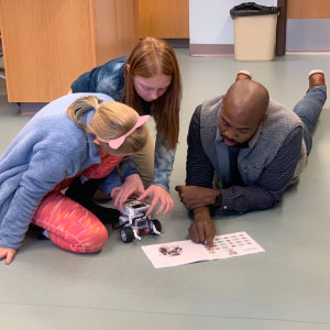 Antoine Sharpe Works With 2 Students