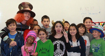 Mr. Sparling with his students on Crazy Hat Day during Read Across America week.