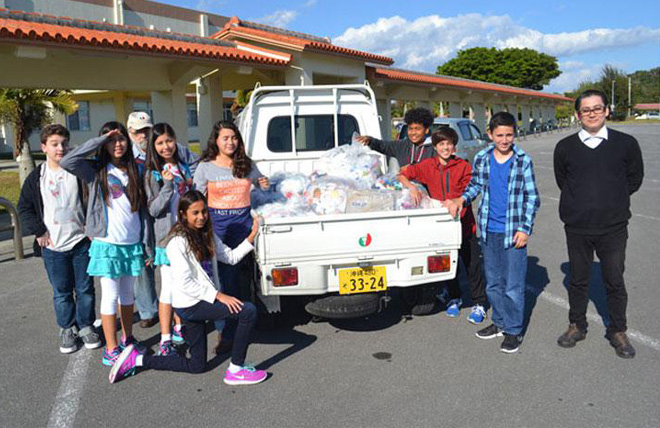 Kadena Middle School cap it off to save world