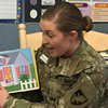 Cadet reads to students