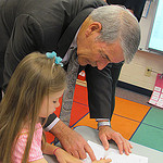 DoDEA Director works with young student at Dexter ES, Ft. Benning, GA