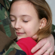 daughter hugging military father